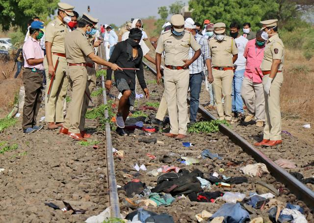 Police officers examine the railway track after a train ran over migrant workers sleeping on the track in Aurangabad district in the western state of Maharashtra, India, May 8, 2020. REUTERS/Stringer