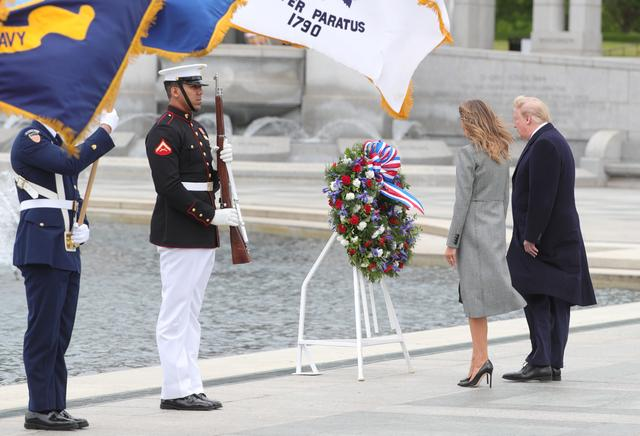 U.S. President Donald Trump and first lady Melania Trump stand in front of a wreath during a Victory in Europe Day 75th anniversary ceremony at the World War II Memorial in Washington, U.S., May 8, 2020. REUTERS/Tom Brenner