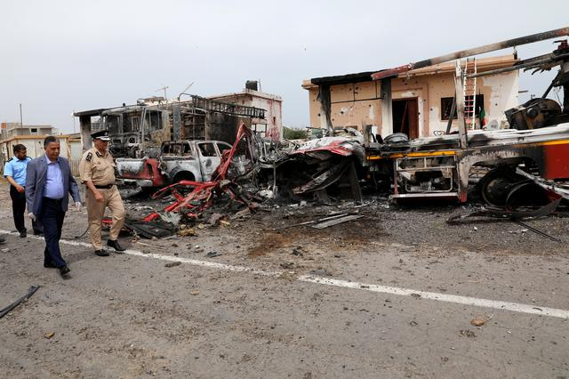 FILE PHOTO: Libyan transport minister Milad Matouq walks as he inspects damages at Tripoli's Mitiga airport after it was hit by shelling in Tripoli, Libya May 10, 2020. REUTERS/Ismail Zitouny/File Photo
