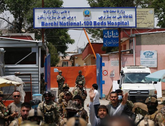 Afghan security forces stand guard outside Dasht-e-Barchi Hospital which came under attack in Kabul, Afghanistan May 12, 2020. REUTERS/Mohammad Ismail