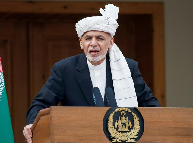 FILE PHOTO: Afghanistan's President Ashraf Ghani speaks during his inauguration as president, in Kabul, Afghanistan March 9, 2020. REUTERS/Mohammad Ismail