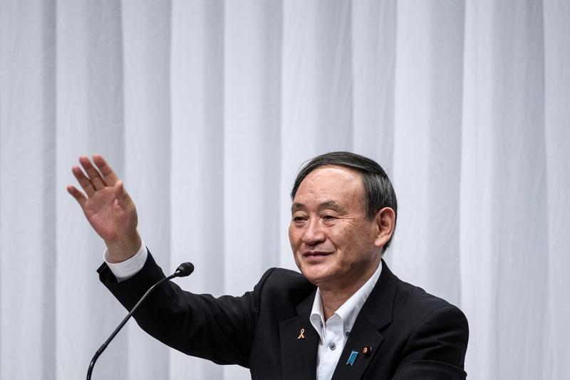 Japan`s Suga poised to win party race, headed...