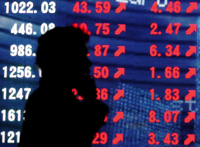 Asian shares on firm footing as vaccine trials resume – Reuters