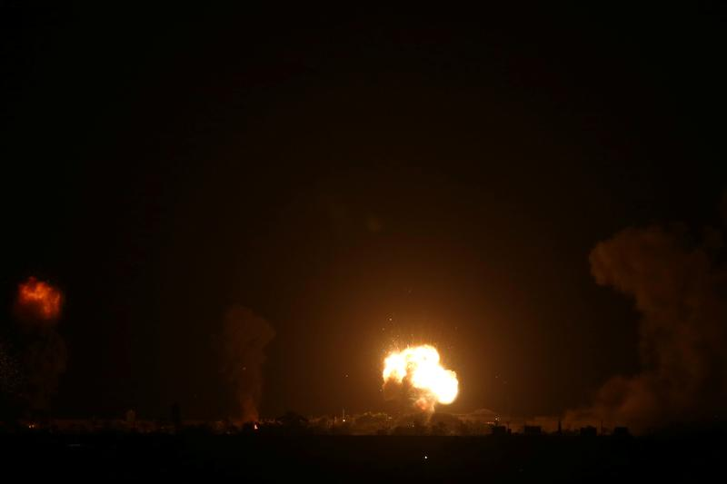 Israeli aircraft strike in Gaza, witnesses say, sirens in southern Israel