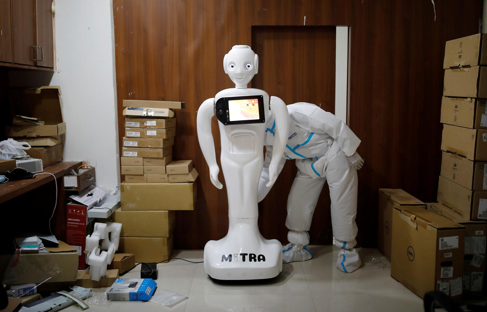 A medical worker puts robot named 'Mitra' , which is used by the patients suffering from the coronavirus disease (COVID-19) to communicate with their relatives, on charge at the Yatharth Super Speciality Hospital in Noida, on the outskirts of New Delhi, India, September 15, 2020.  REUTERS/Adnan Abidi