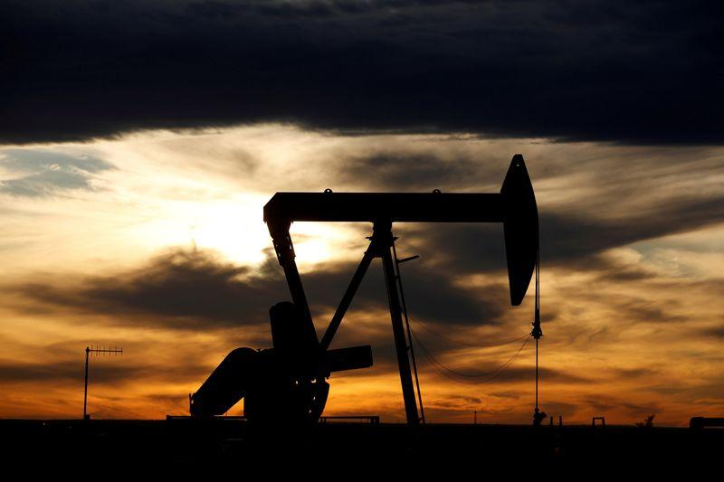 Oil edges up as U.S. storm eases, but recovery fears persist