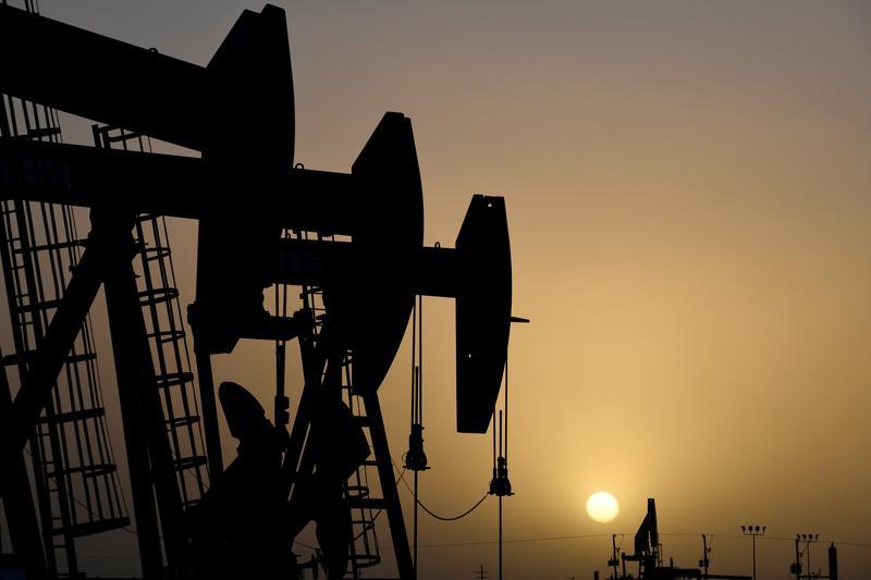 Oil rises as U.S. storm eases, but demand worries linger