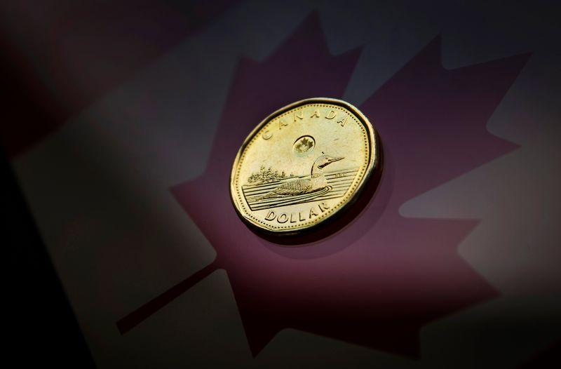 The Canadian dollar was little changed against its U.S. counterpart on Tuesday as some calm returned to oil and global equity markets following steep declines the day before, with the currency recovering from an earlier near six-week low.