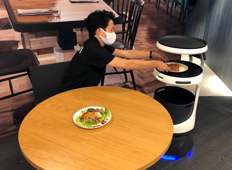 SoftBank brings food service robot to labour-strapped Japan - Reuters