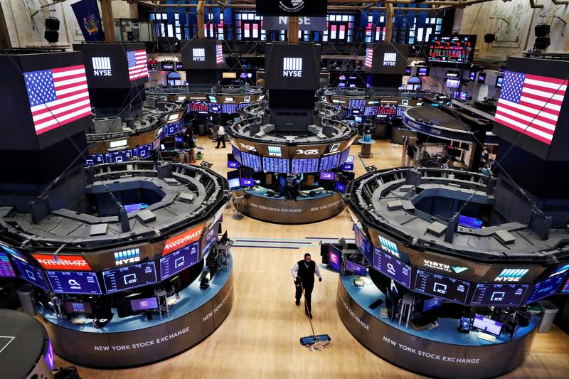 Wall Street jumps on stimulus hopes, upbeat data