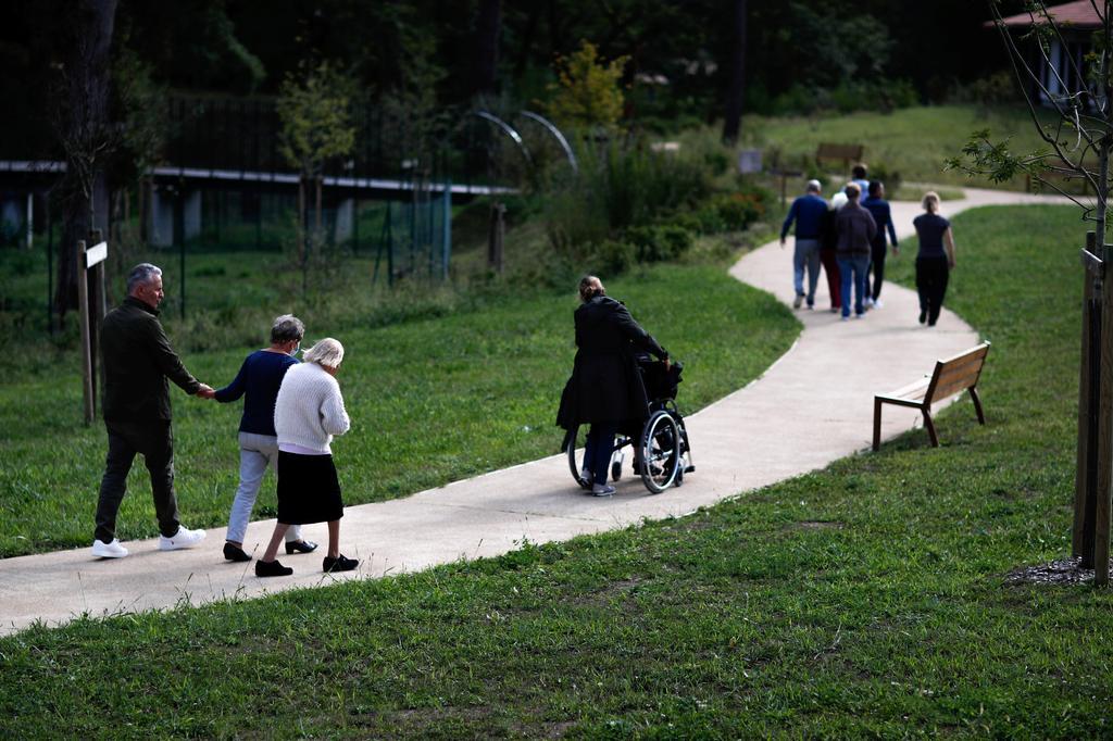 FILE PHOTO: Alzheimer's patients walk at the Village Landais Alzheimer site in Dax, France, September 24, 2020. REUTERS/Gonzalo Fuentes