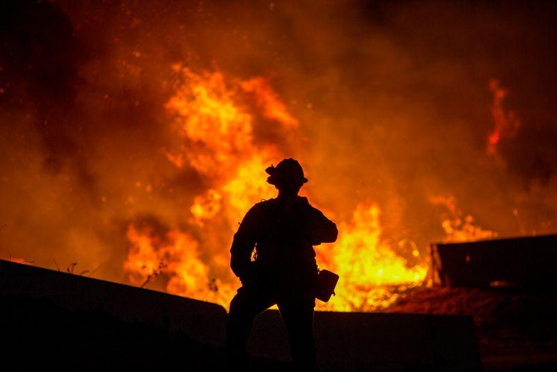 Wind-whipped Southern California wildfires prompt mass evacuations, injure two firefighters
