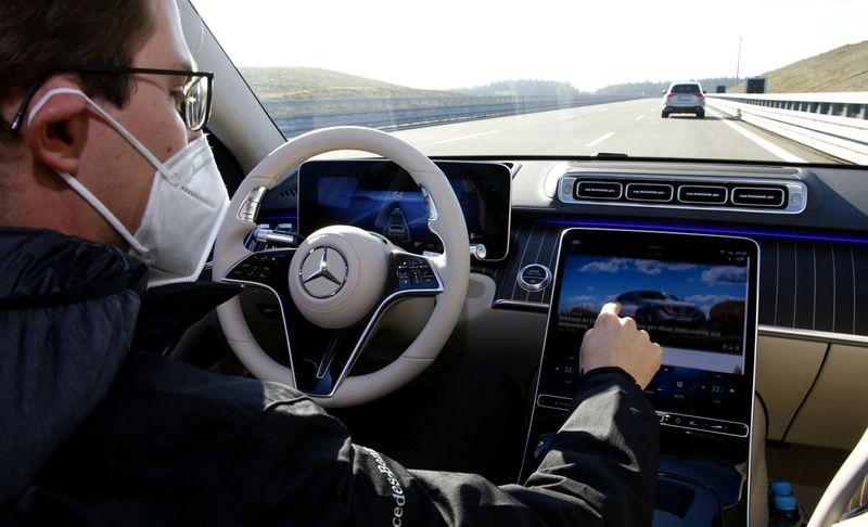Mercedes bets on evolution as Tesla touts revolution in automated driving - Reuters