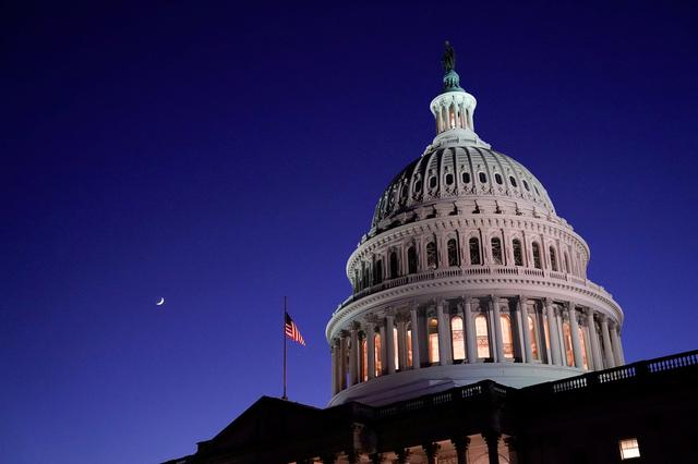 FILE PHOTO: The U.S. Capitol dome is seen at night in Washington, U.S., December 17, 2020. REUTERS/Erin Scott