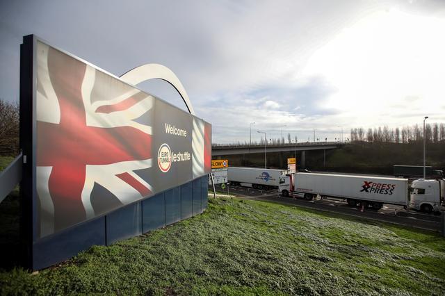 FILE PHOTO: Lorries queue on the M20 motorway to enter the Eurotunnel terminal in Folkestone, Britain, December 18, 2020. REUTERS/Peter Cziborra