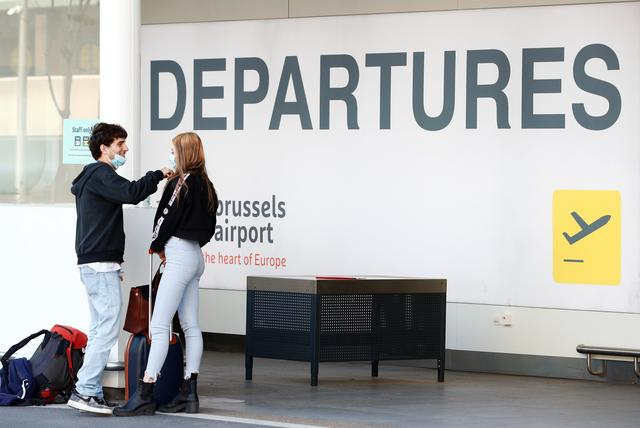 Passengers wearing face masks stand at the Zaventem International Airport as Belgium eases restrictions aimed to contain the spread of the coronavirus disease (COVID-19) outbreak, near Brussels, Belgium June 15, 2020. REUTERS/Francois Lenoir