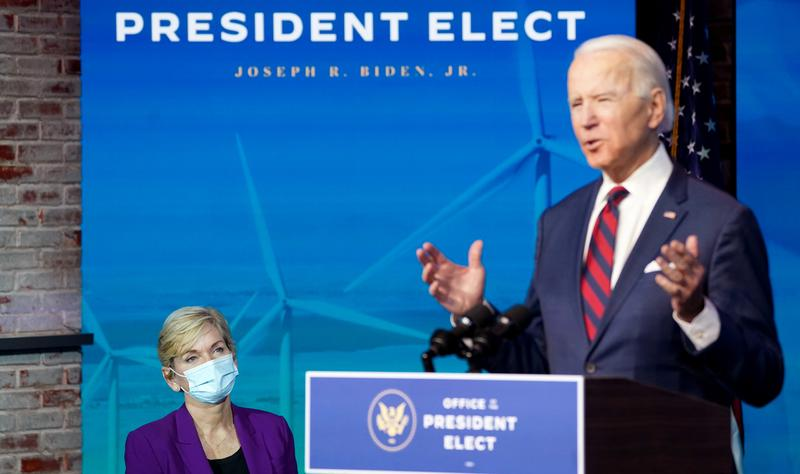 Former Michigan Governor Jennifer Granholm, U.S. President-elect Joe Biden's nominee for Secretary of Energy, listens as U.S. President-elect Joe Biden introduces key members of his administration in Wilmington, Delaware, U.S., December 19, 2020. REUTERS/Kevin Lamarque