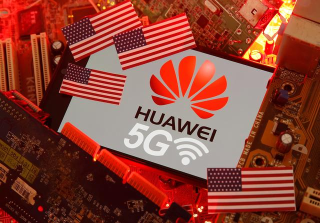 FILE PHOTO: The U.S. flag and a smartphone with the Huawei and 5G network logo are seen on a PC motherboard in this illustration taken January 29, 2020. REUTERS/Dado Ruvic/Illustration