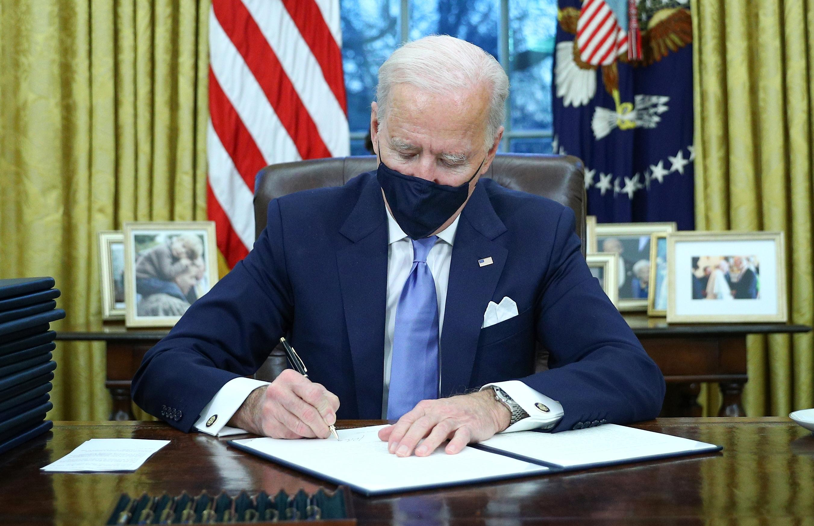 Biden announces return to global climate accord, new curbs on U.S. oil industry