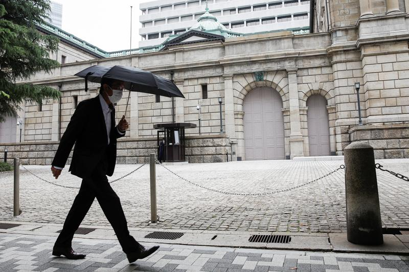 Bank of Japan lifts next year's growth forecast, saves ammunition as virus risks linger - Reuters