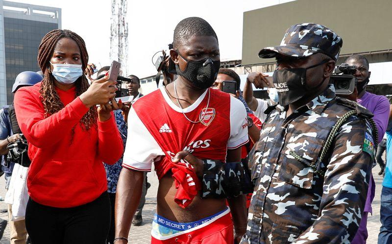 Nigerian Police Beat, Arrest Protesters at Reopening of Lekki Shooting Site Where 12 Activists Were Killed