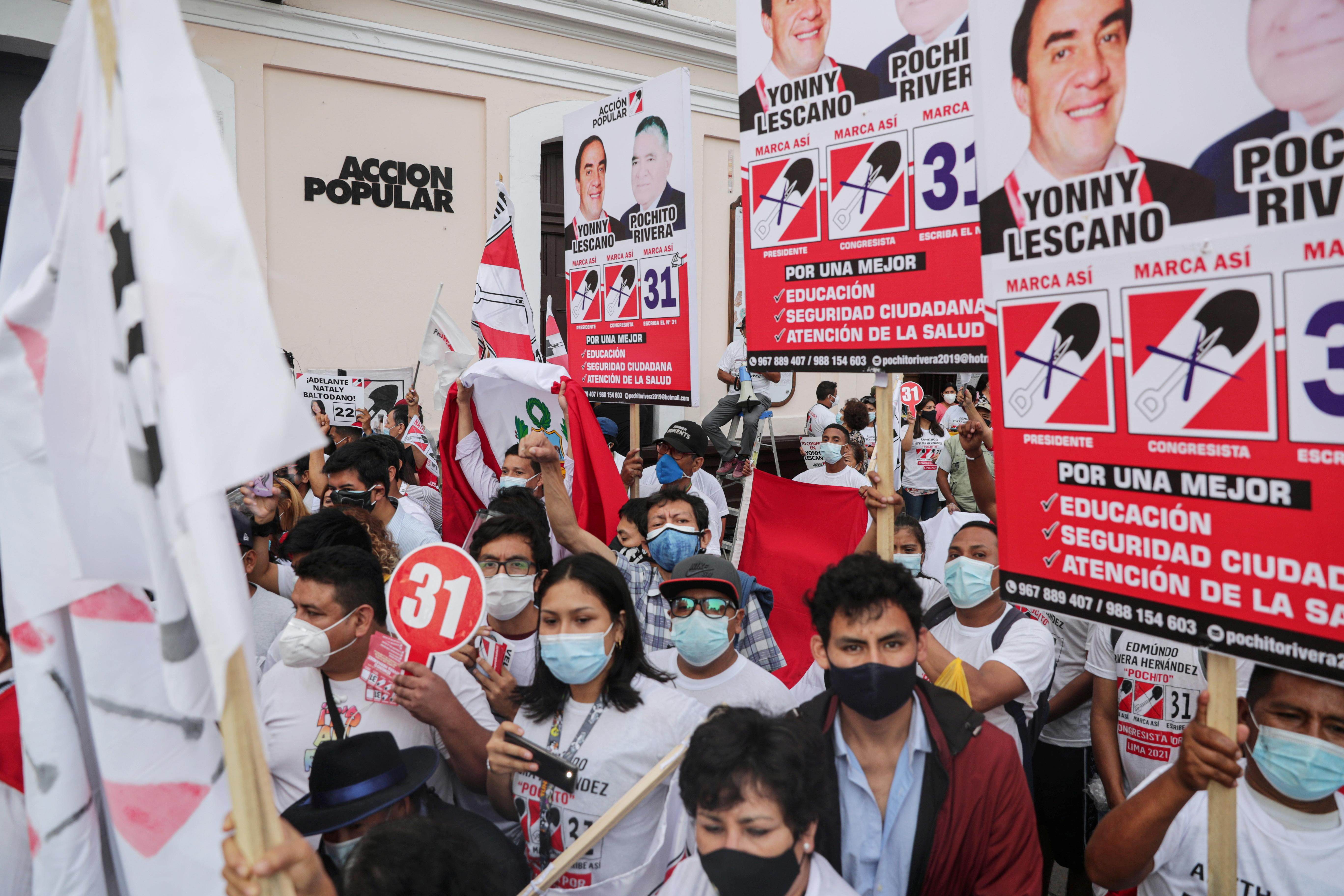 Peruvians head to polls with masks, pens and little excitement