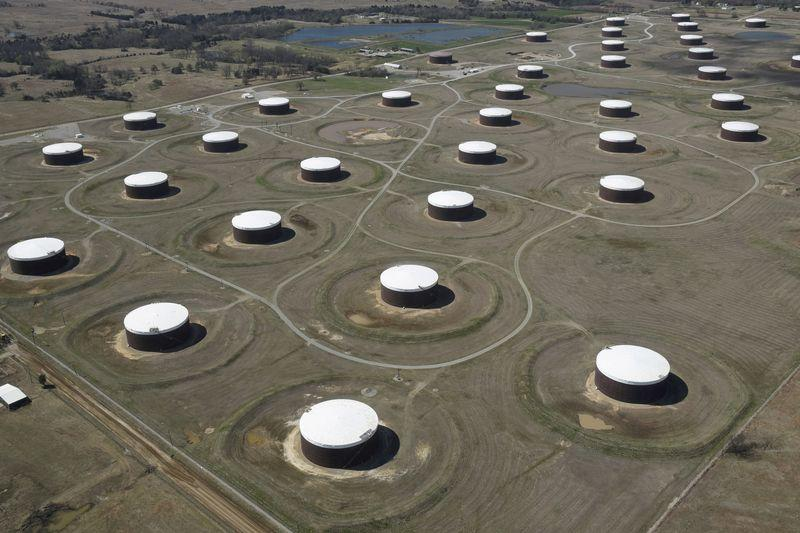 Oil nudges lower but set for weekly gain on demand recovery hopes