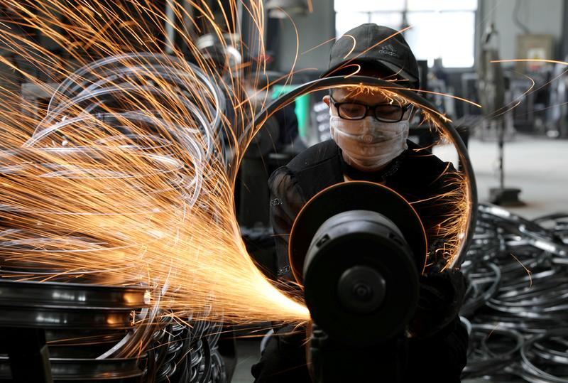 China's industrial output growth slows in April, retail sales miss forecasts