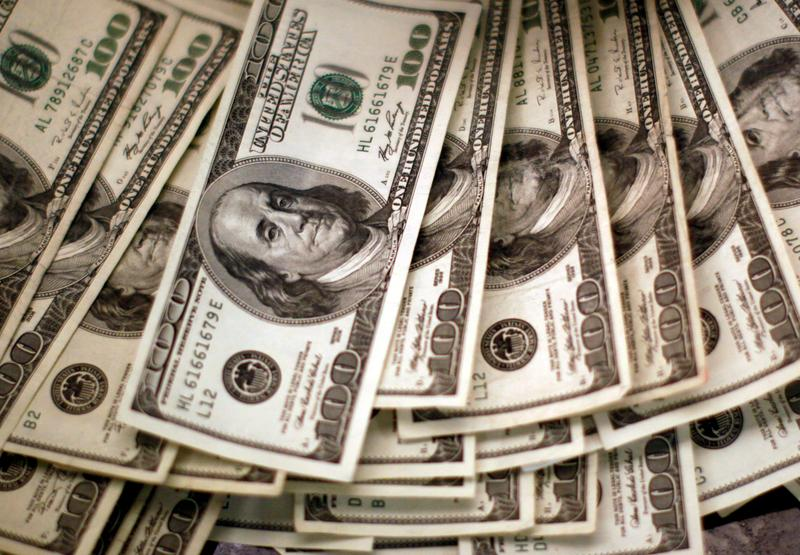 Dollar holds above recent lows as traders wait for inflation data
