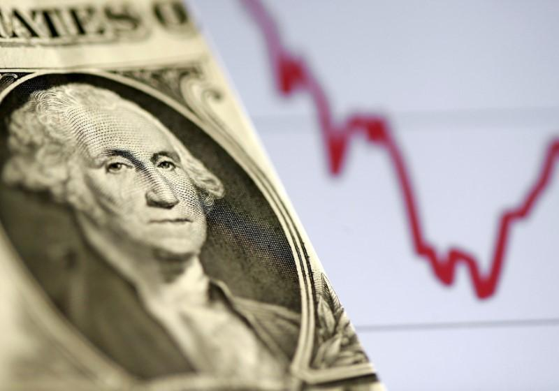 Dollar holds near one-month high with focus on Fed's inflation take