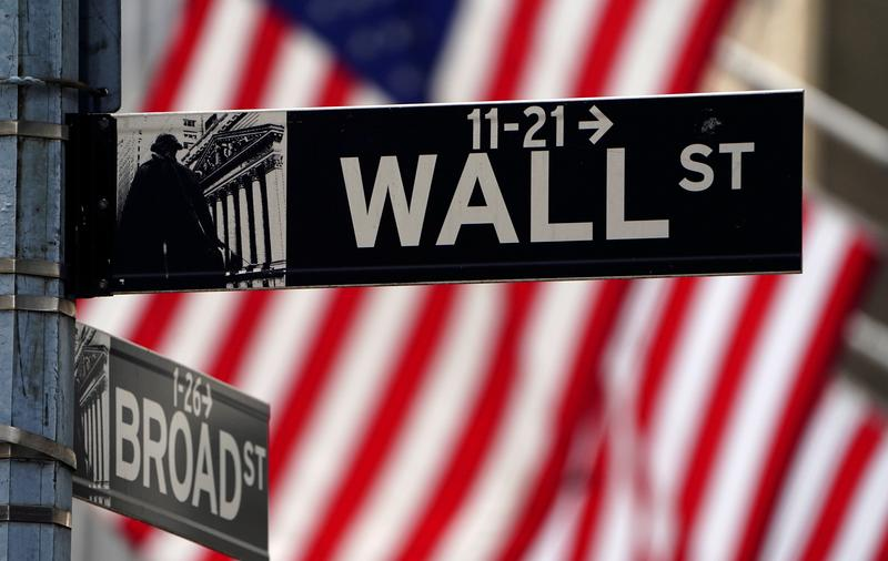 Wall Street closes lower as Fed officials project rate hikes for 2023