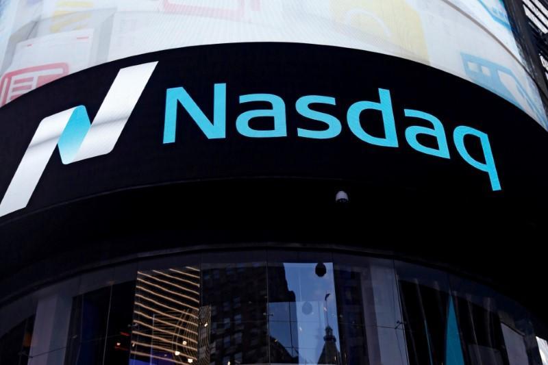 Nasdaq closes up on tech stocks strength, as hawkish Fed limits S&P