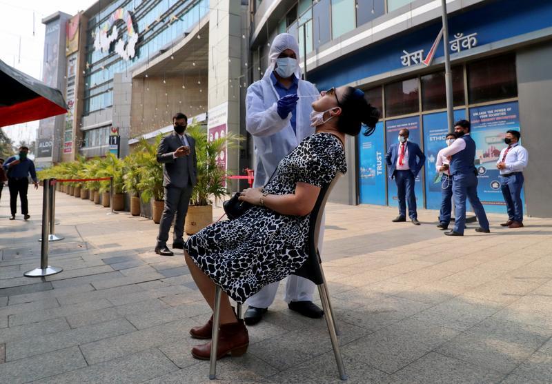 India reports 60,753 new coronavirus cases - Reuters