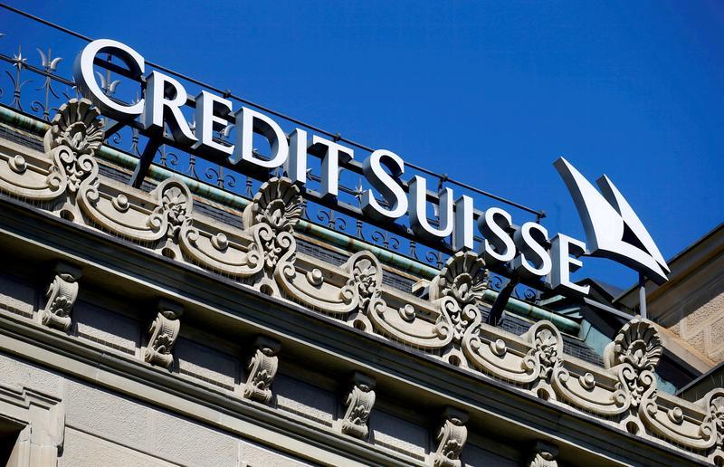 Fearing predators, Credit Suisse seeks new look or even merger - sources