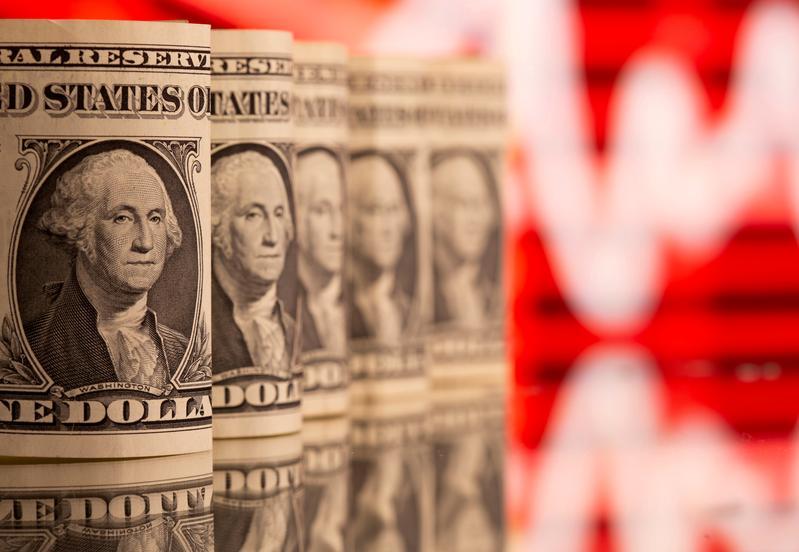Dollar holds near three-week high after U.S. data boost