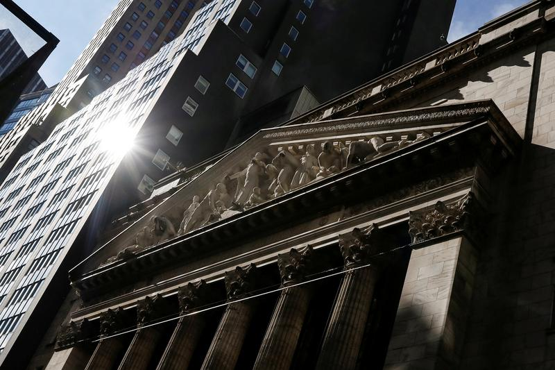 U.S. stock index futures edged lower on Friday, led by banking and technology shares following a sharp rally in the past two days after the Federal Reserve kept its policy stance largely in line with market expectations.